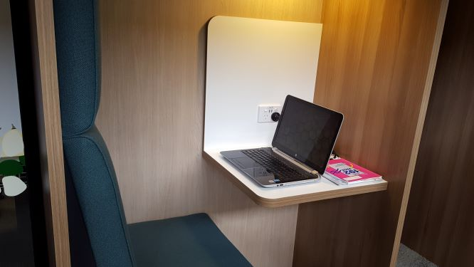 A study space featuring a desk and laptop.