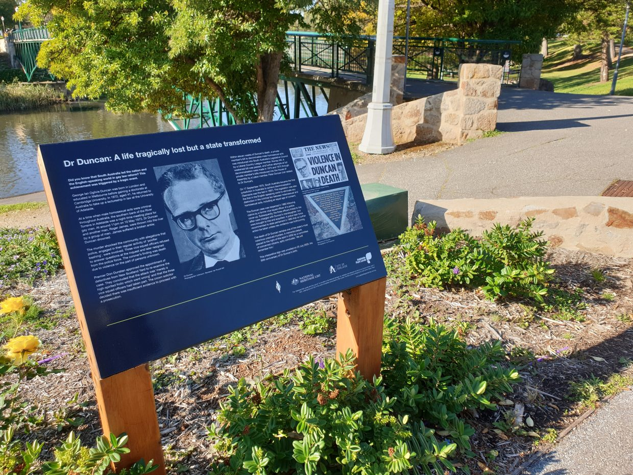 A memorial plaque details the story of gay man George Duncan.